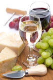 Grapes, hard cheese and two glasses of wine, vertical Stock Photo