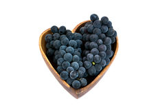 Grapes in a heart shape wooden plate. Close up Stock Photo