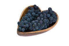 Grapes in a heart shape wooden plate stock image