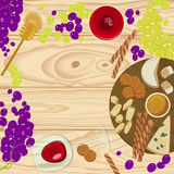 Grapes, honey, cheese with glass of wine Royalty Free Stock Photos