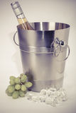 Grapes, ice bucket with bottle of  Wine   on a white background Stock Photography