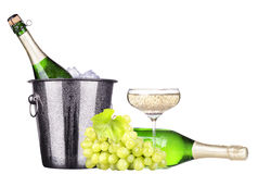 Grapes, ice bucket  with champagne isolated Royalty Free Stock Photo