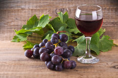 Grapes. Image of a bunch of grapes on wooden table stock photos