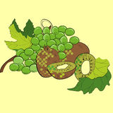 Grapes and kiwi. Isolated on yellow background Royalty Free Stock Photos