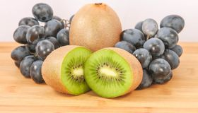 Grapes with kiwi Stock Photography