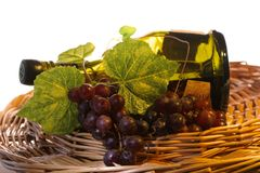 Grapes with leaf and wine in a Royalty Free Stock Photo