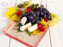 Grapes , leafs and cheese Royalty Free Stock Photography