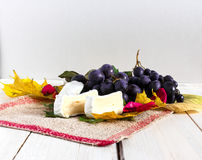 Grapes , leafs and cheese Stock Photo