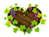 Grapes with leaves in the form of heart Stock Photography