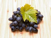 Grapes with leaves Stock Images