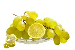 Grapes and lemon  on the white isolated background Royalty Free Stock Image