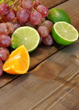 Grapes, limes, lemons and oranges Royalty Free Stock Photos