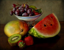 Grapes, mango, kiwi, strawberries and watermelon Royalty Free Stock Photography
