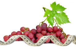 Grapes with measuring tape Royalty Free Stock Image