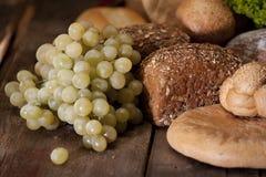 Grapes near bread Royalty Free Stock Photos