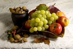 Grapes nuts and apples. Arrangement of apples, grapes and nuts stock photo