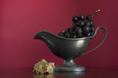 Grapes in old bowl Stock Photo