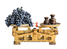 Grapes on old scales Royalty Free Stock Image