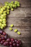 Grapes on old wooden background Stock Photos