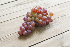 Grapes on old wooden table Stock Photography