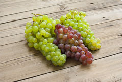 Grapes on old wooden table Royalty Free Stock Photo