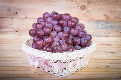 Grapes on a old wooden table. stock photos