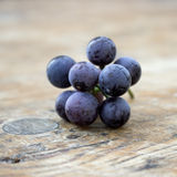Grapes on a old wooden table. Royalty Free Stock Images