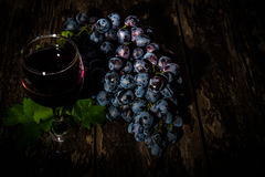 Grapes on a old wooden table Stock Photos