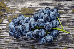 Grapes on an old wooden table Royalty Free Stock Photo