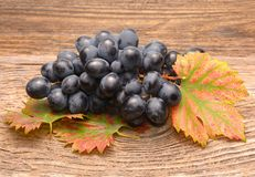 Grapes on a old wooden table Royalty Free Stock Images