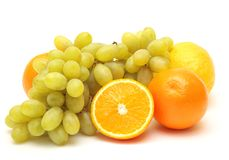 Grapes and oranges Stock Photography