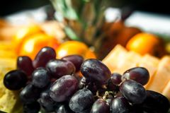 Grapes and other fruits on a plateau royalty free stock photo