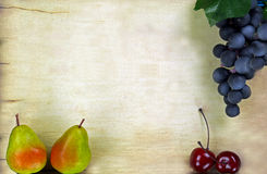 Grapes on a paper with copy space. Purple Grapes and pears on a paper with copy space Royalty Free Stock Photography