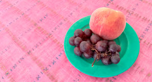 Grapes With Peach in a Plate Stock Photo