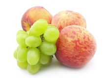 Grapes and  peaches Royalty Free Stock Photos