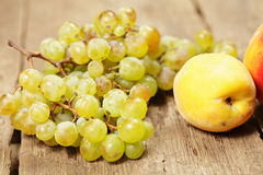 Grapes and peaches Stock Image