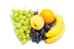 Grapes, peaches, bananas and orange. On a white background Royalty Free Stock Photos