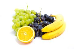 Grapes, peaches, bananas and orange Stock Photography