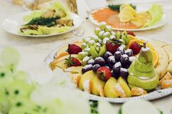 Grapes, pear, kiwi and other fruits. royalty free stock photography