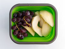 Grapes and Pear in Lunch Box Royalty Free Stock Images