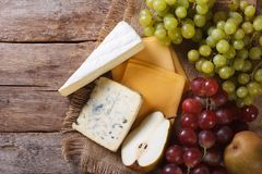 Grapes, pears and cheese on the table. horizontal top view Stock Image