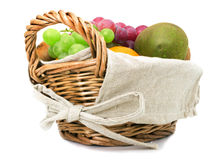 Fruits in the basket on a white background Royalty Free Stock Image