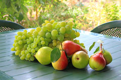Grapes and pears on the table Royalty Free Stock Image
