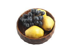 Grapes and pears in the wooden bowl Stock Photos