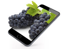 Grapes on phone screen Stock Photography
