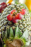 Grapes and Pineapple. Grapes placed on a Pineapple royalty free stock photo