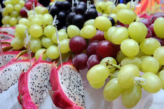Grapes and pitahaya Royalty Free Stock Images