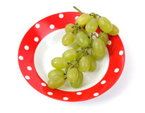 Grapes on a plate Stock Images