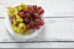Grapes on a plate Royalty Free Stock Image