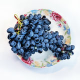Grapes on plate Royalty Free Stock Photos